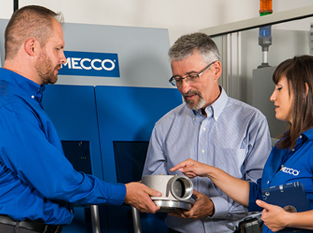 MECCO employees working with customer