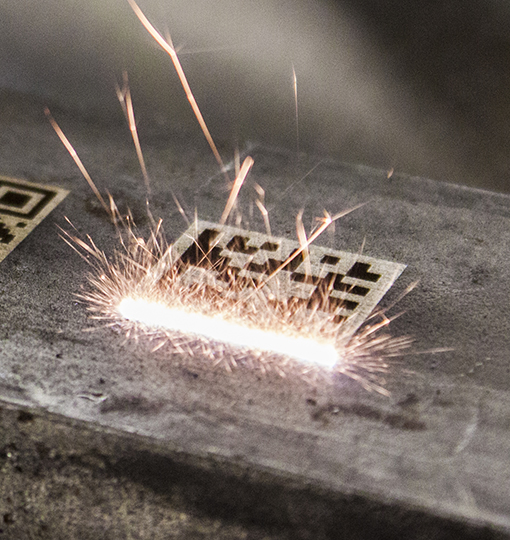 Laser etching a barcode
