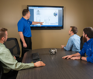 Laser operations team conducting product management meeting